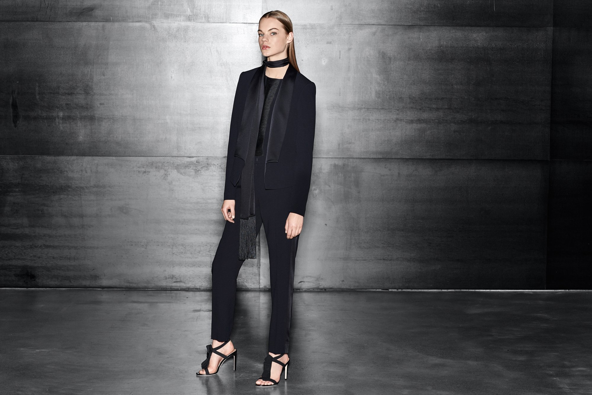 Black jacket over black blouse and black trousers with black shoes by BOSS