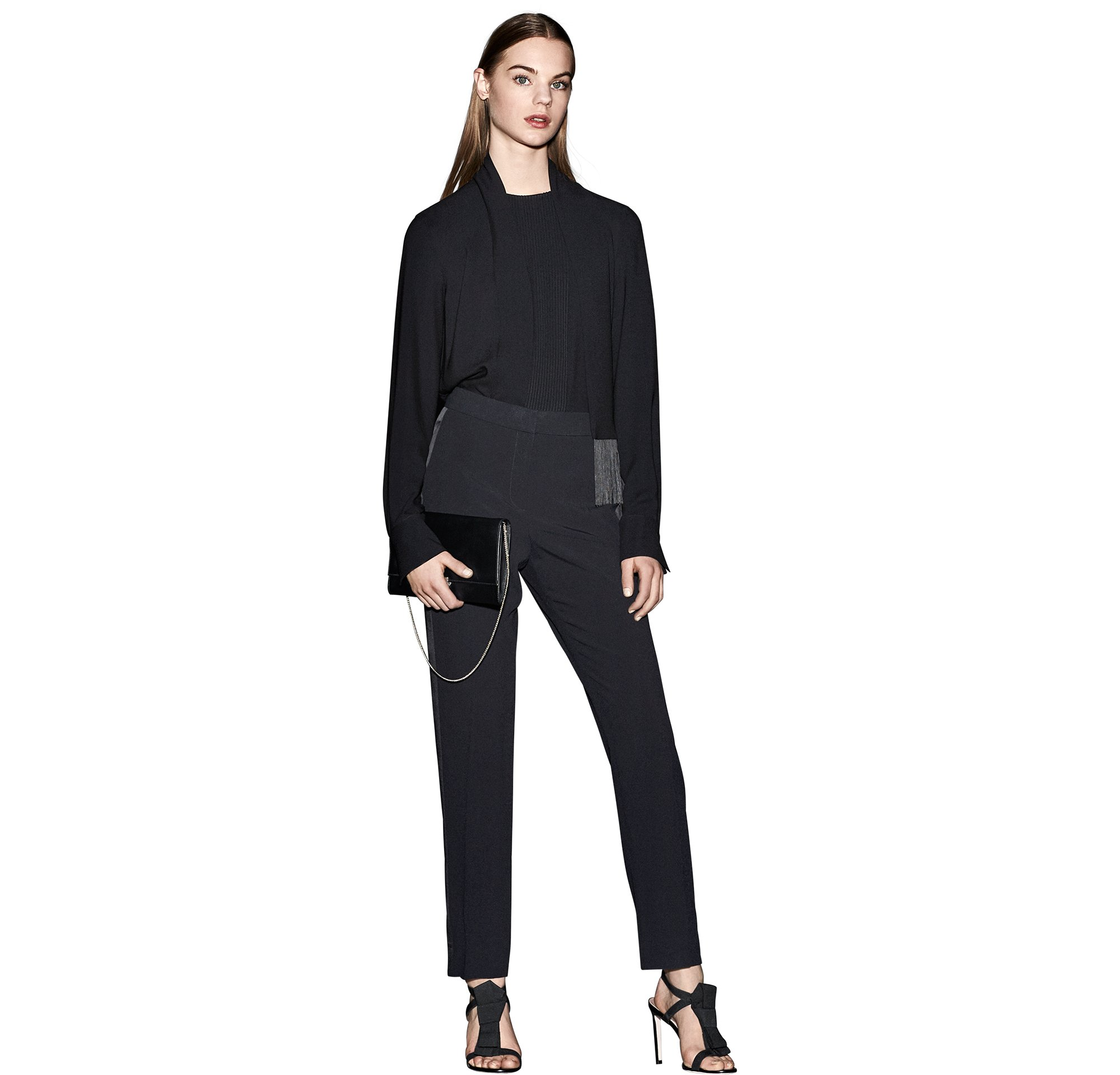 Black blouse over black trousers with a black bag and black shoes by BOSS