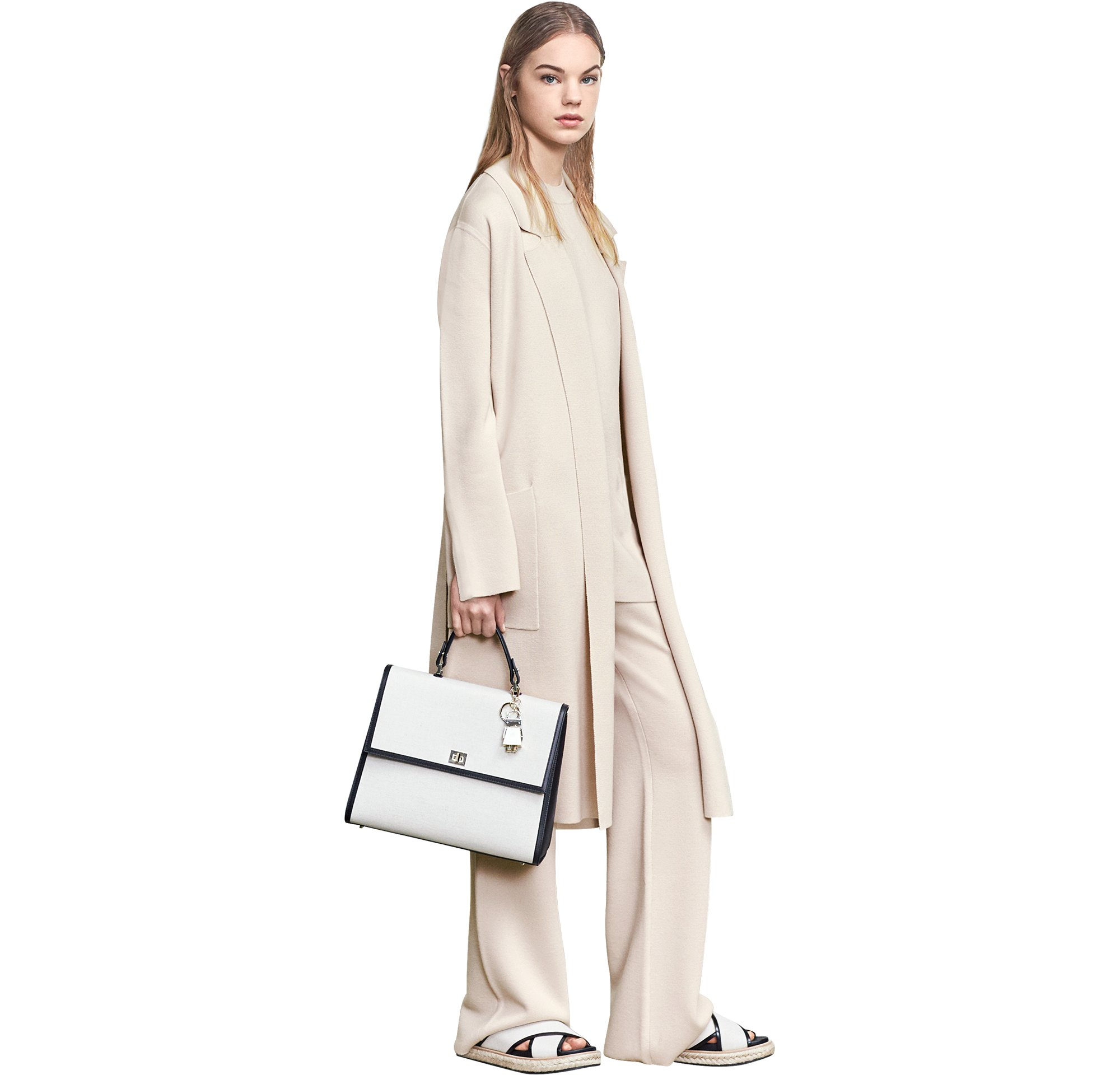 Light beige knitwear over knitwear and trousers with leather bag and shoes by BOSS
