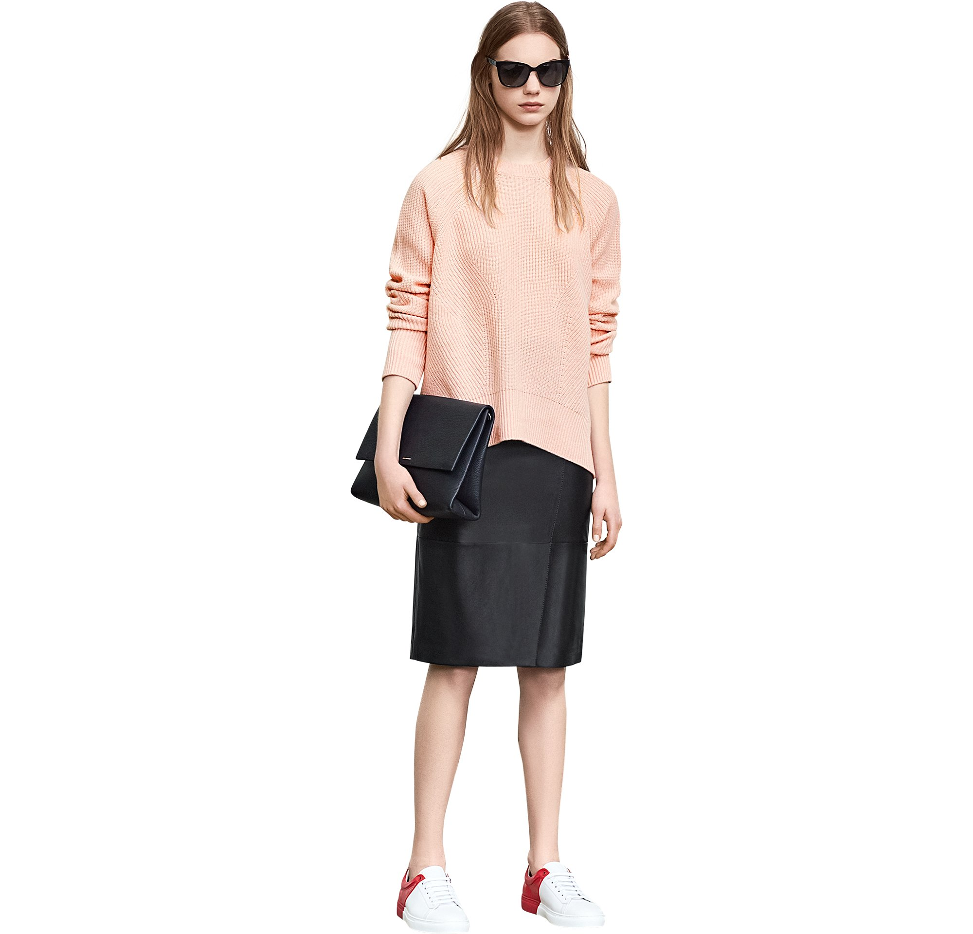 Light pink knitwear over black leather skirt with bag and shoes by BOSS