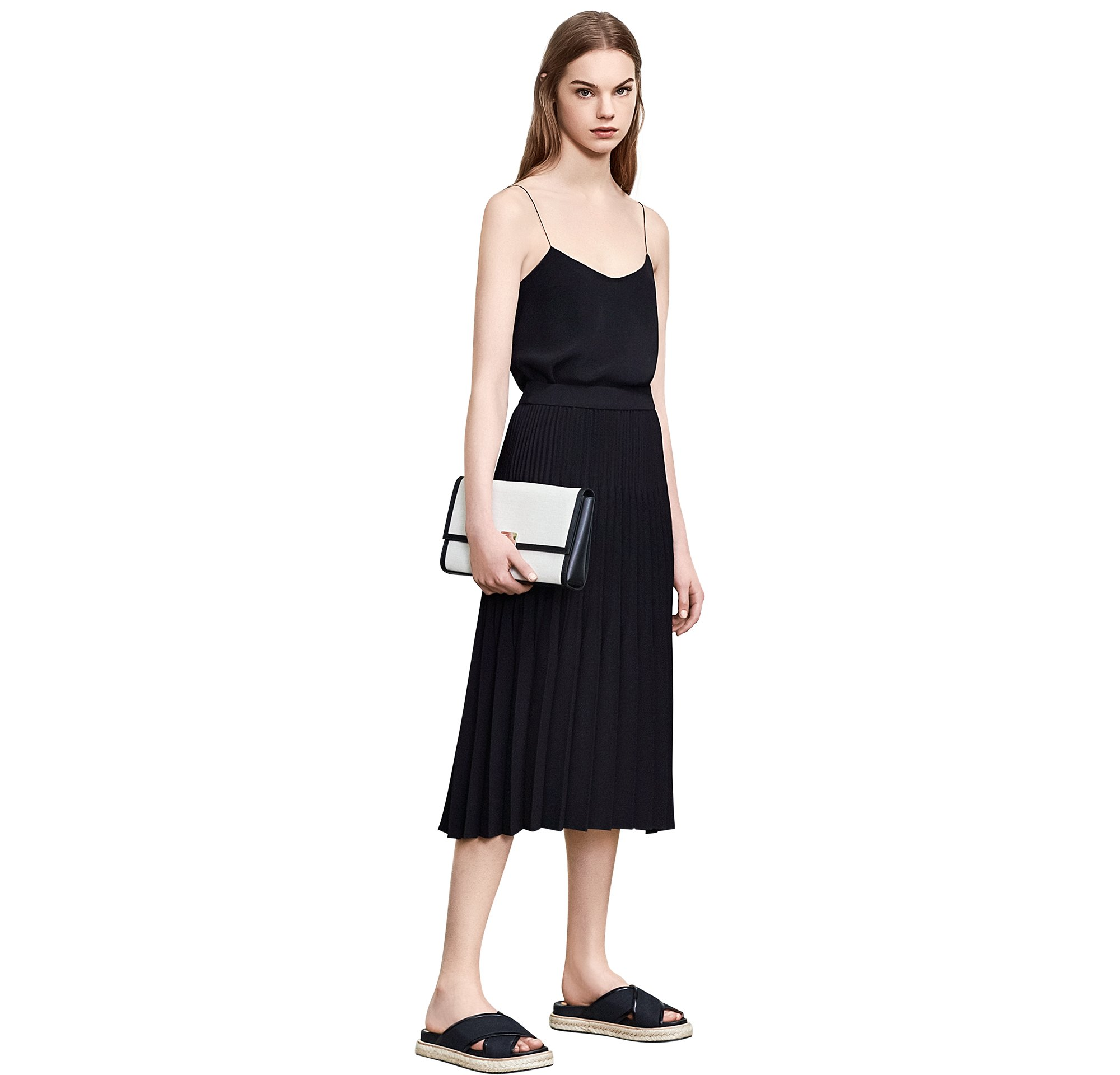 Black top over black skirt with shoes and bag by BOSS