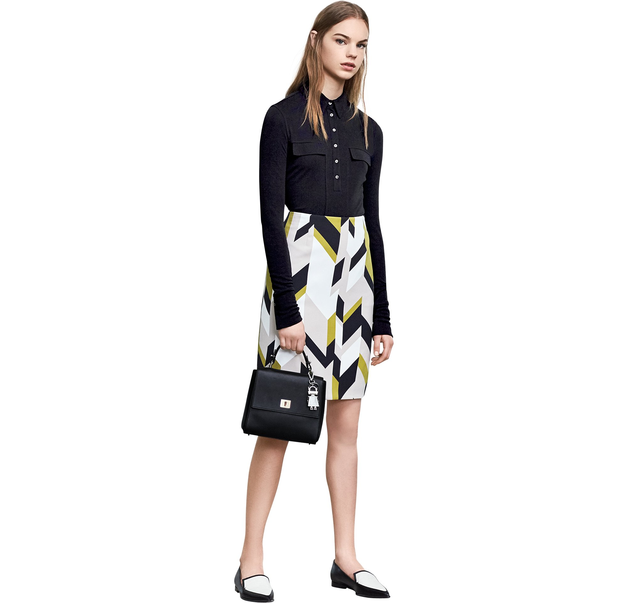 Black jersey over patterned skirt with bag and shoes by BOSS