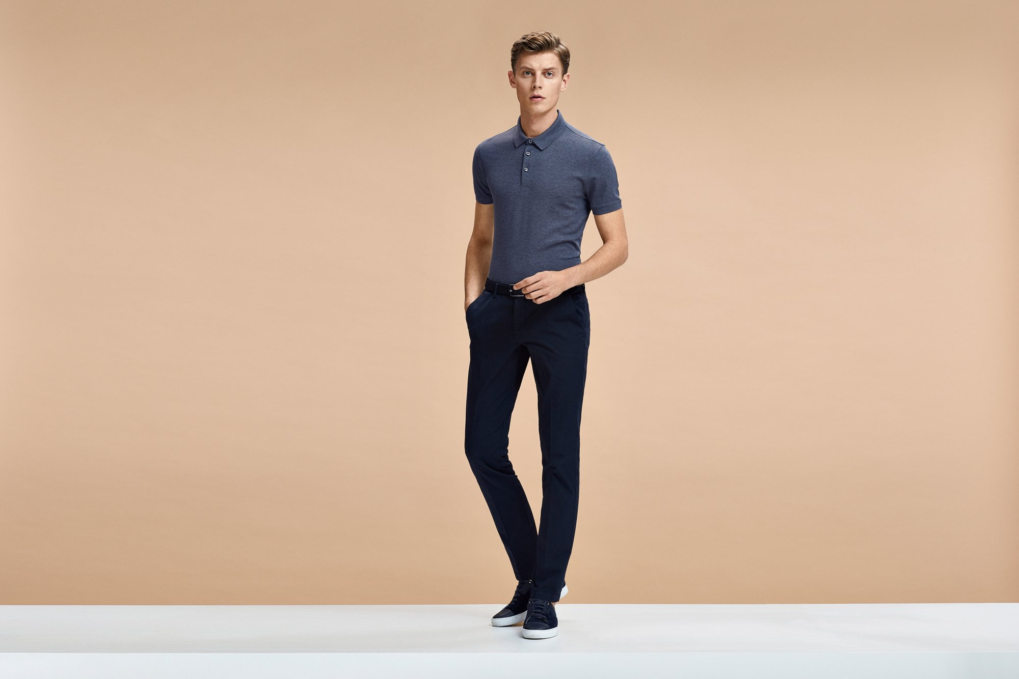 Grey polo shirt, black jeans and black sneakers by BOSS Menswear