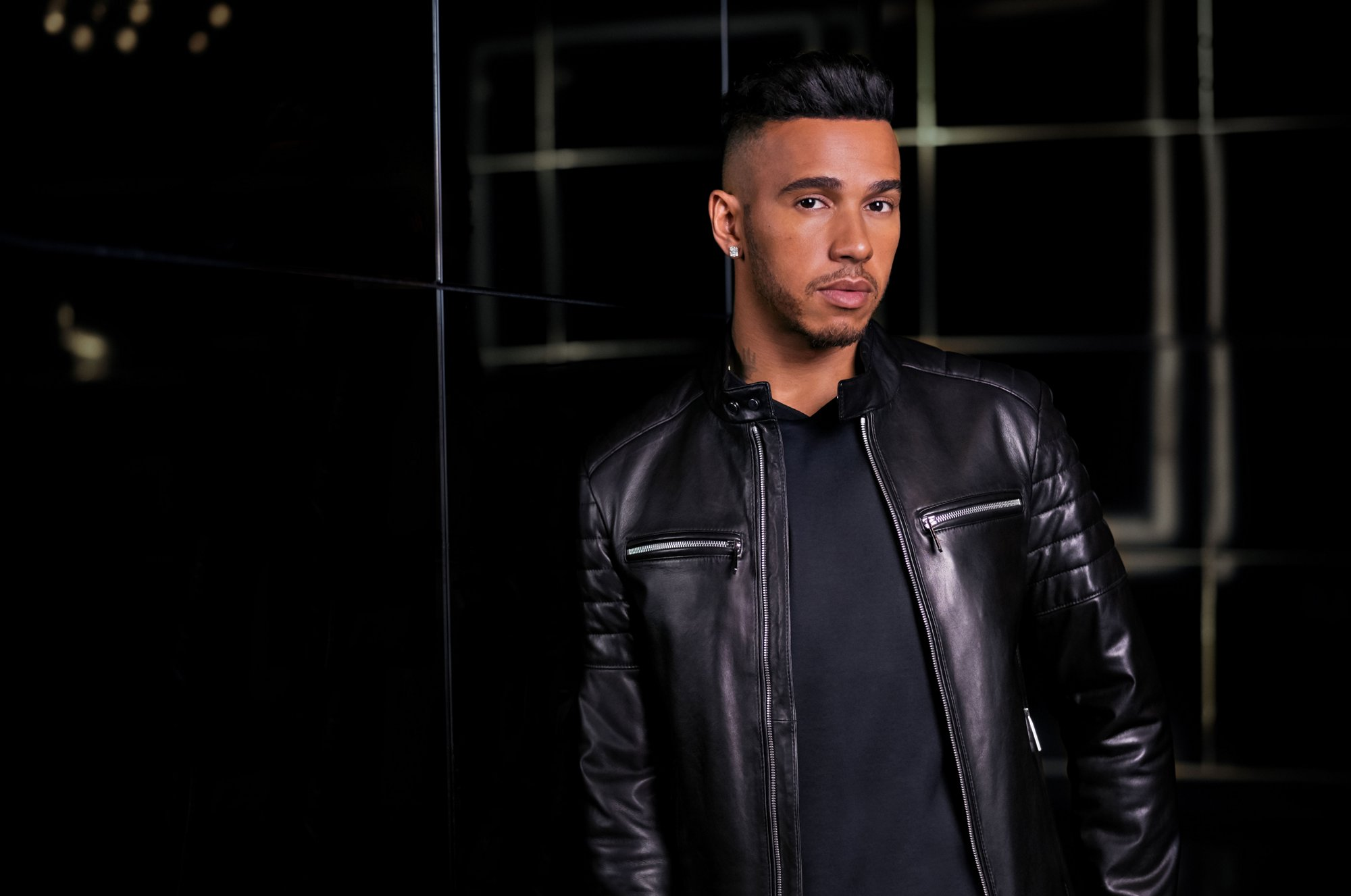 Lewis Hamilton wearing a black leather jacket by BOSS