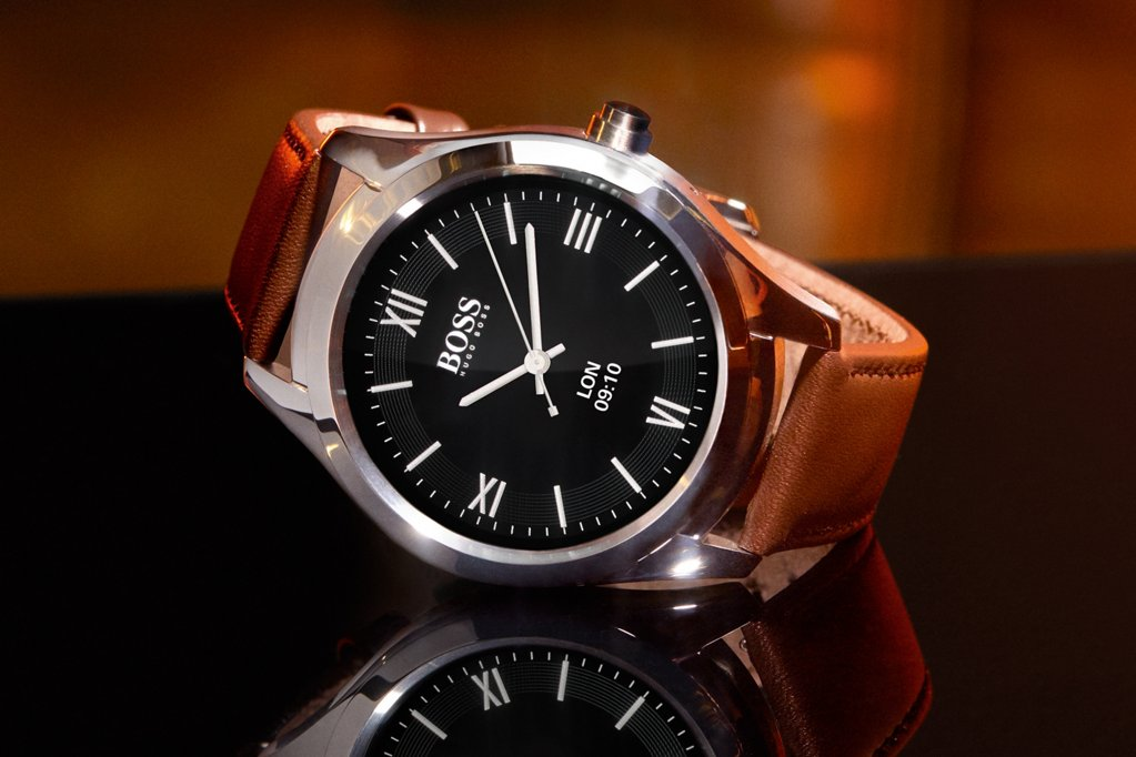 6a2419cd45cfa7 ... Touch watch from BOSS with brown leather strap and a customizable  display