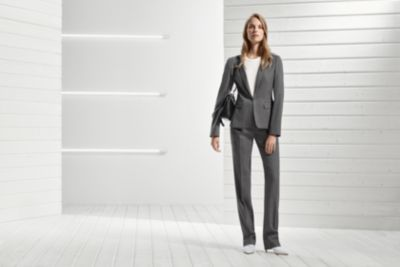 Woman is wearing grey suit from BOSS Womenswear