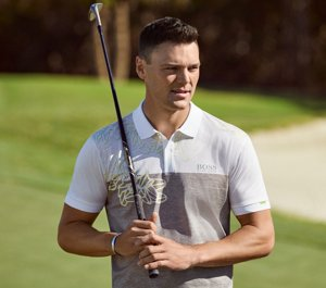 d6c849356 Martin Kaymer wearing a polo shirt and golf trousers by BOSS ...