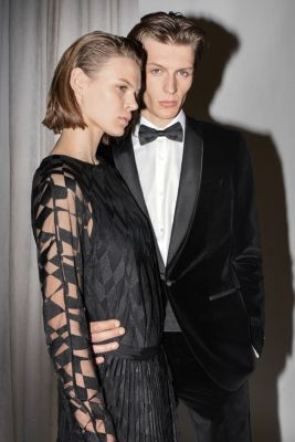 Men and women wearing party looks from BOSS