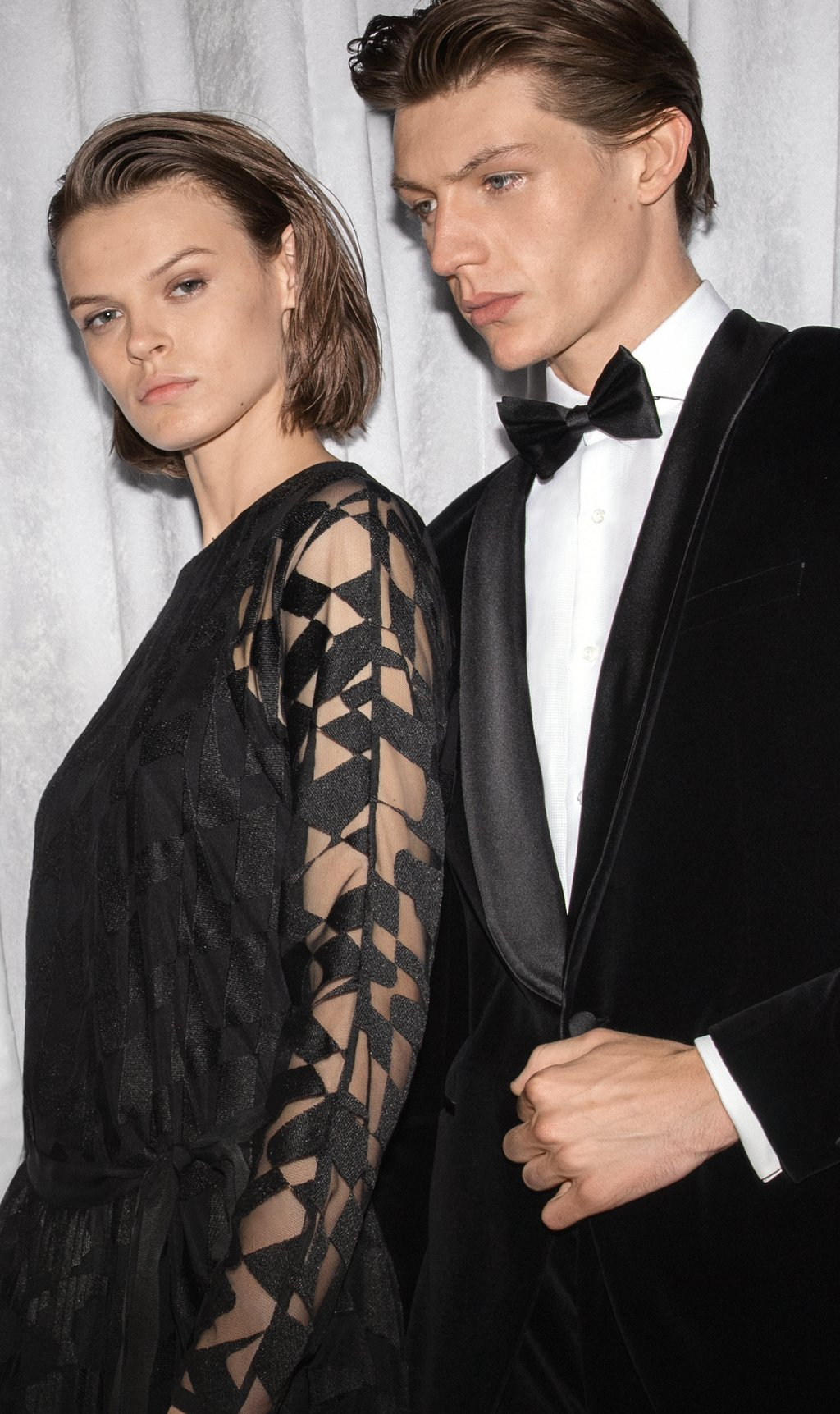 0a5c23350 ... Male and female models wearing evening looks from BOSS