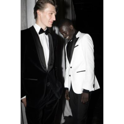 Male models wearing black and white tuxedo from BOSS