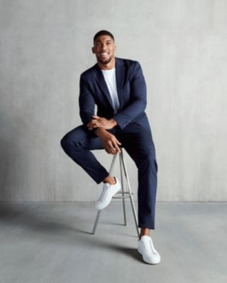 Anthony Joshua wearing a dark blue suit and a white t-shirt by BOSS