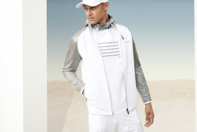 Man is wearing a white sweatshirt, white trousers, white cap and grey shoes by BOSS