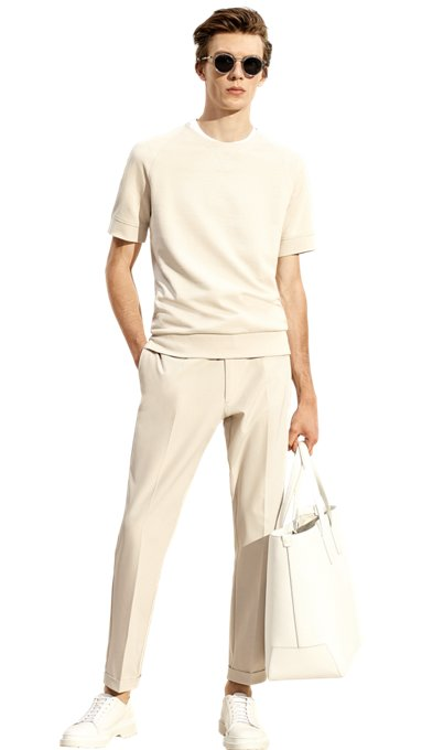 7ef6926d Discover more from Spring/Summer 2019. Man is wearing a beige jersey, white  t-shirt, beige trousers, ...