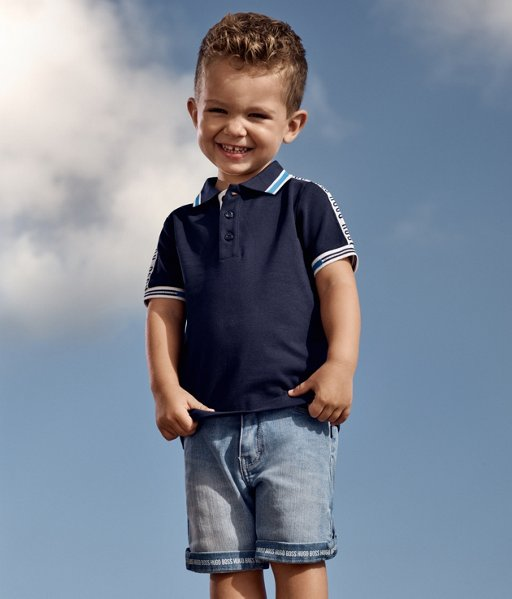 ... Infant boy wearing a navy polo shirt and denim shorts from BOSS 62b1ef943