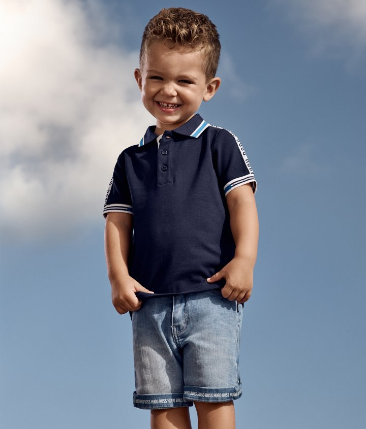 f39e28ee6 Infant boy wearing a navy polo shirt and denim shorts from BOSS ...