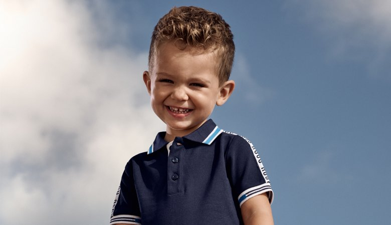 865a23de ... Toddler is wearing a navy polo shirt and denim shorts from BOSS