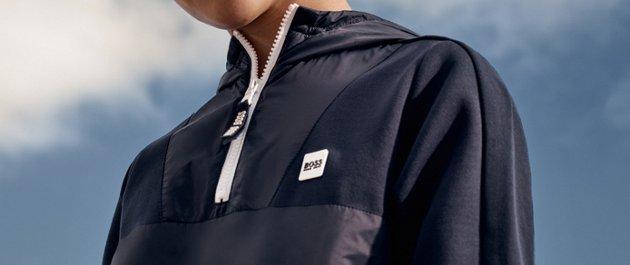 90ba56bc Boy is wearing a navy hoodie sweatshirt from BOSS ...