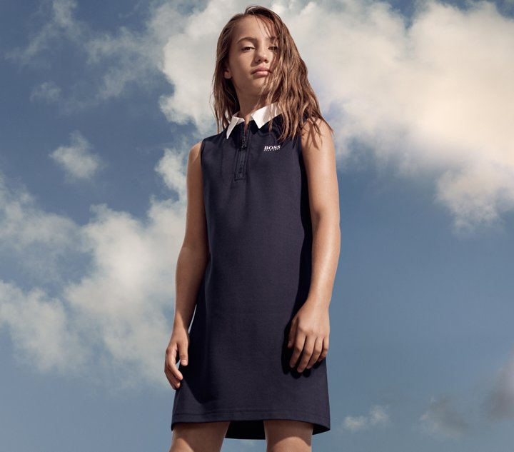 Girl is wearing a navy dress from BOSS ... c109d3f27