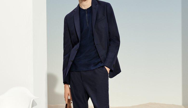 cfa8926b9 ... Man is wearing a dark blue jacket, dark blue sweater, dark blue  trousers,