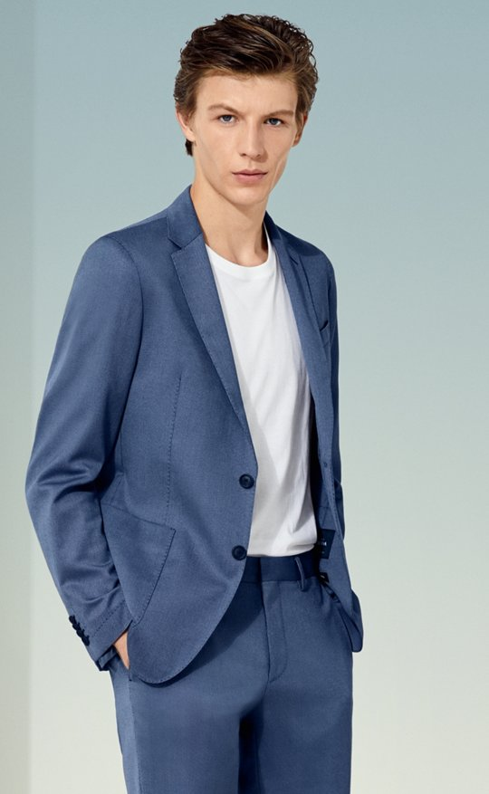 24ccf12b9 Slim-fit jacket in pure cotton with AMF stitching by BOSS. Quick Shop · Man  is wearing a blue jacket, white t-shirt, blue trousers and white ...