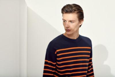 Man wearing a blue and orange striped knitwear  from BOSS