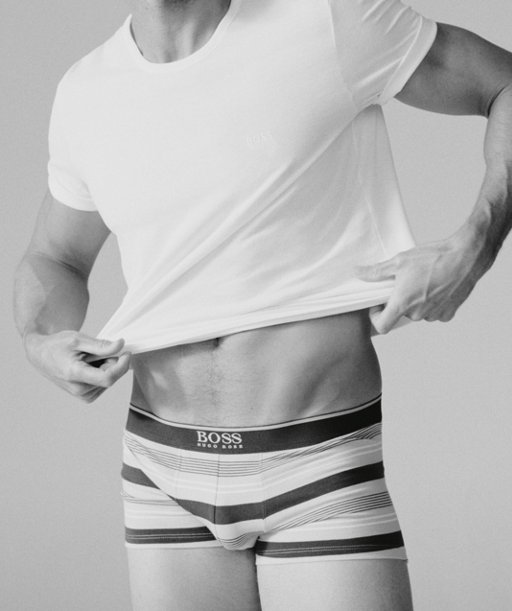 a4962c613 ... Andrew Cooper wearing white T-shirt and stripe trunk from BOSS