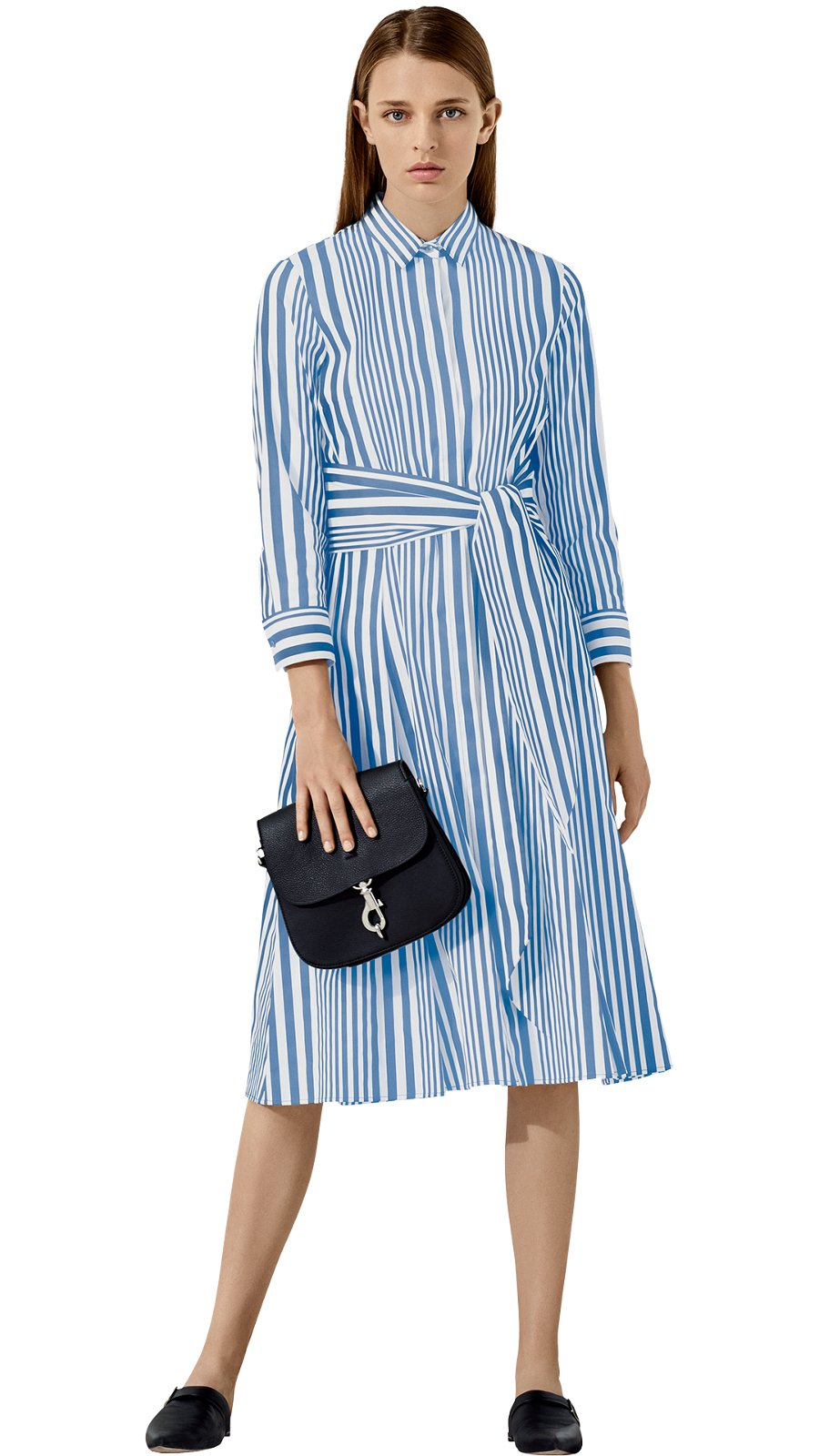 bb505e9e8e62 Woman is wearing a striped Debraba dress together with black Linda loafers  and a black Crosstown ...