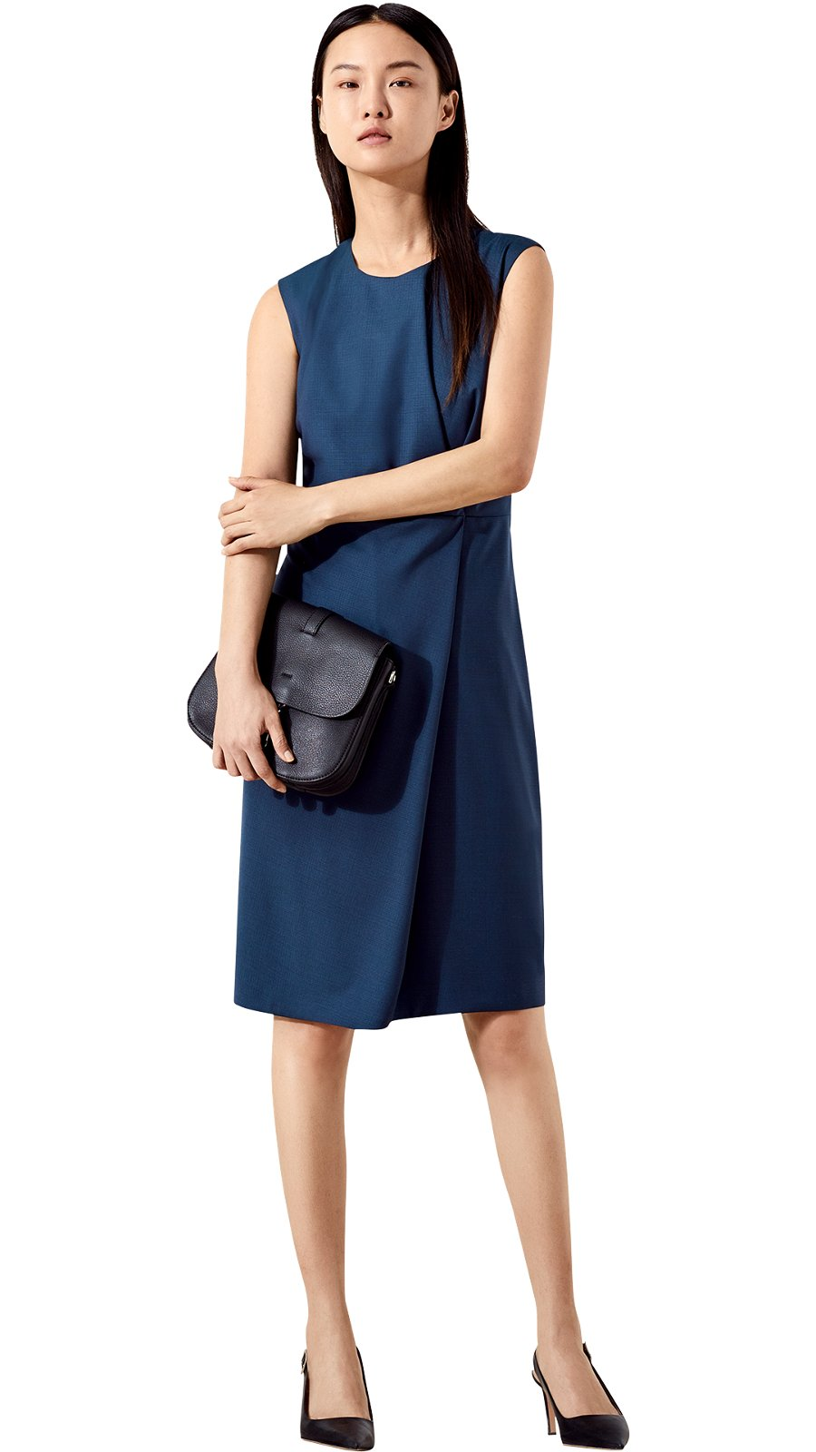 8847d31db755 Woman is wearing a blue Dathea dress together with black Linda sling shoes  from BOSS ...