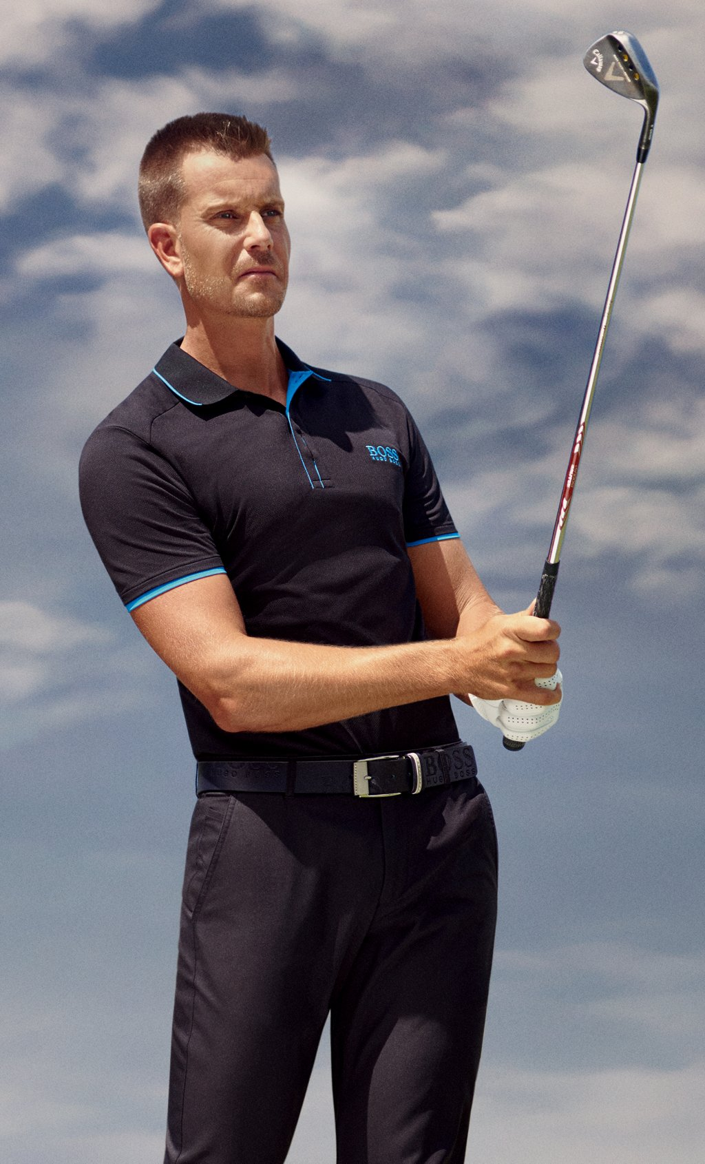 23d85f818 ... Martin Kaymer wearing a polo shirt and pants by BOSS