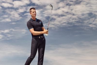 Martin Kaymer wearing a polo shirt and pants by BOSS