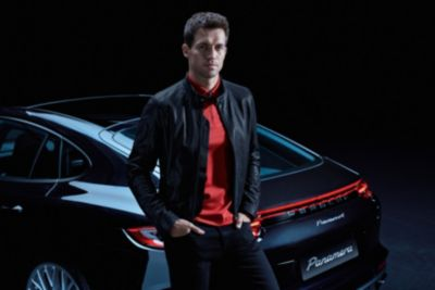 Male model wearing black leather jacket with a red slim-fit polo shirt