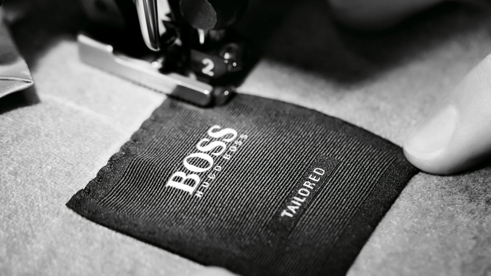 7ecdee339 Tailoring process of the BOSS Tailored suit: Stitching the BOSS label ...