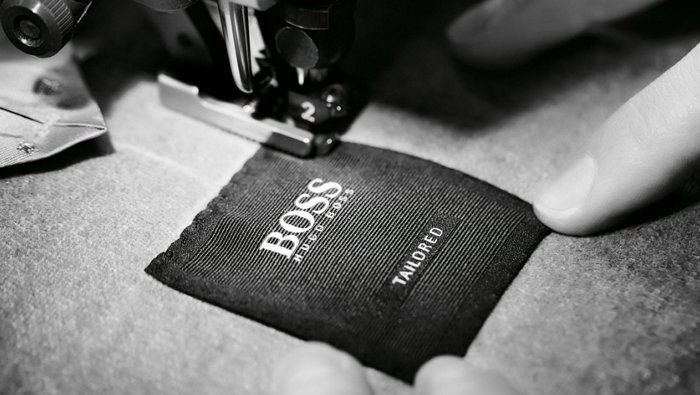 Tailoring process of a BOSS Tailored suit: stitching the label