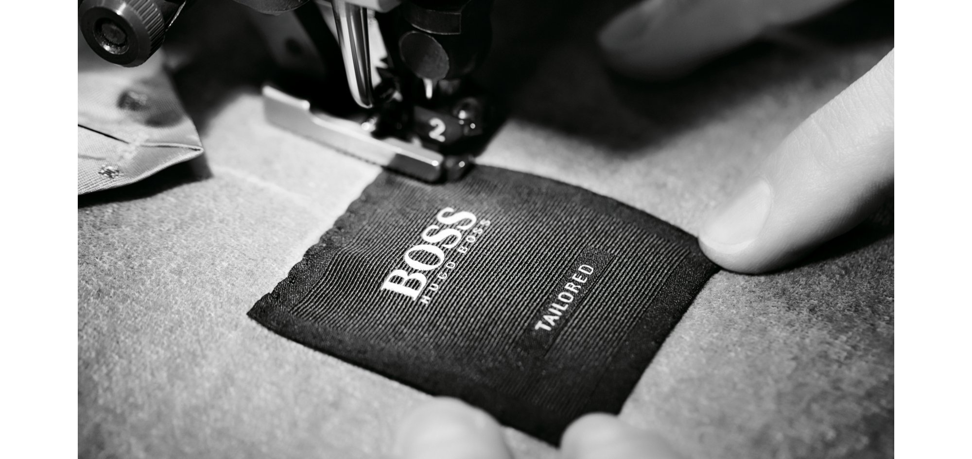 Tailoring process of the BOSS Tailored suit: Stitching the BOSS label