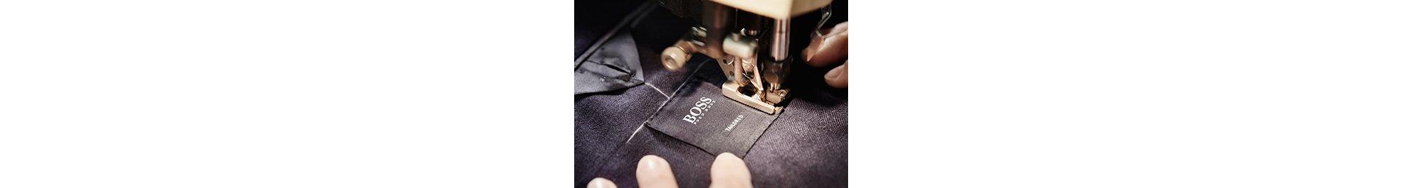 Anzug von BOSS Tailored. In Italien gefertigtes Gewebe, aus dem die Anzüge von BOSS Tailored hergestellt werden