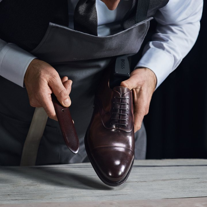 a6049468 BOSS shoe maker working on a Made to Measure shoe ...