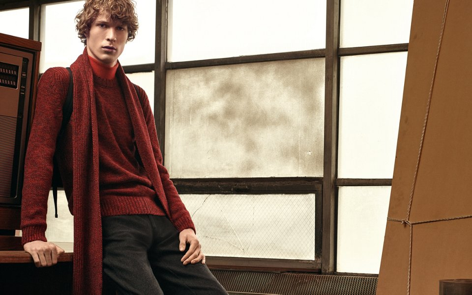 Red knitwear over red knitwear and black trousers with a red scarf and black shoes by BOSS