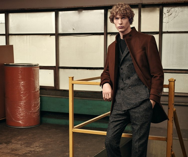 Brown coat over black suit over black knitwear and brown shoes  by BOSS