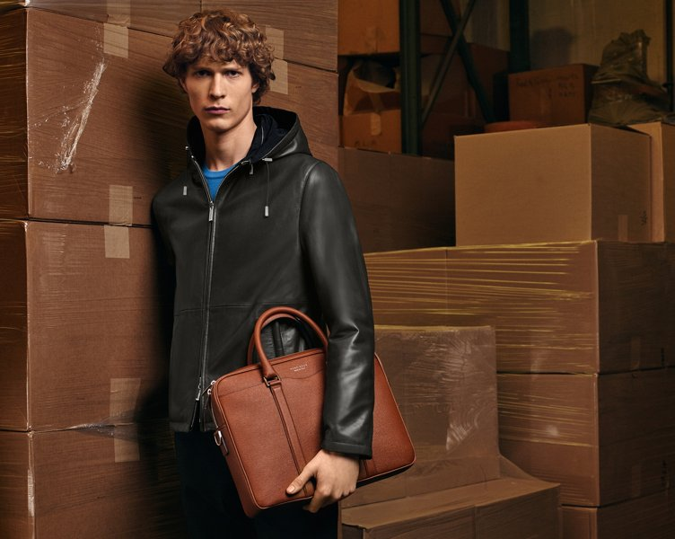 Leather jacket, pullover, trousers and Signature bag by BOSS