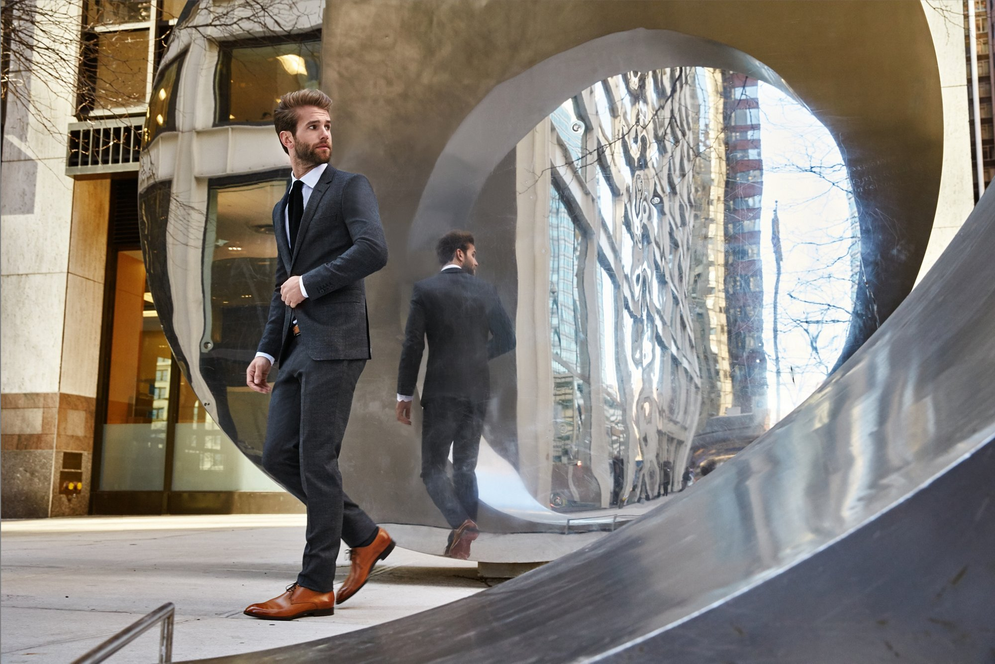 André Hamann in brown tailored shoes and grey suit by BOSS