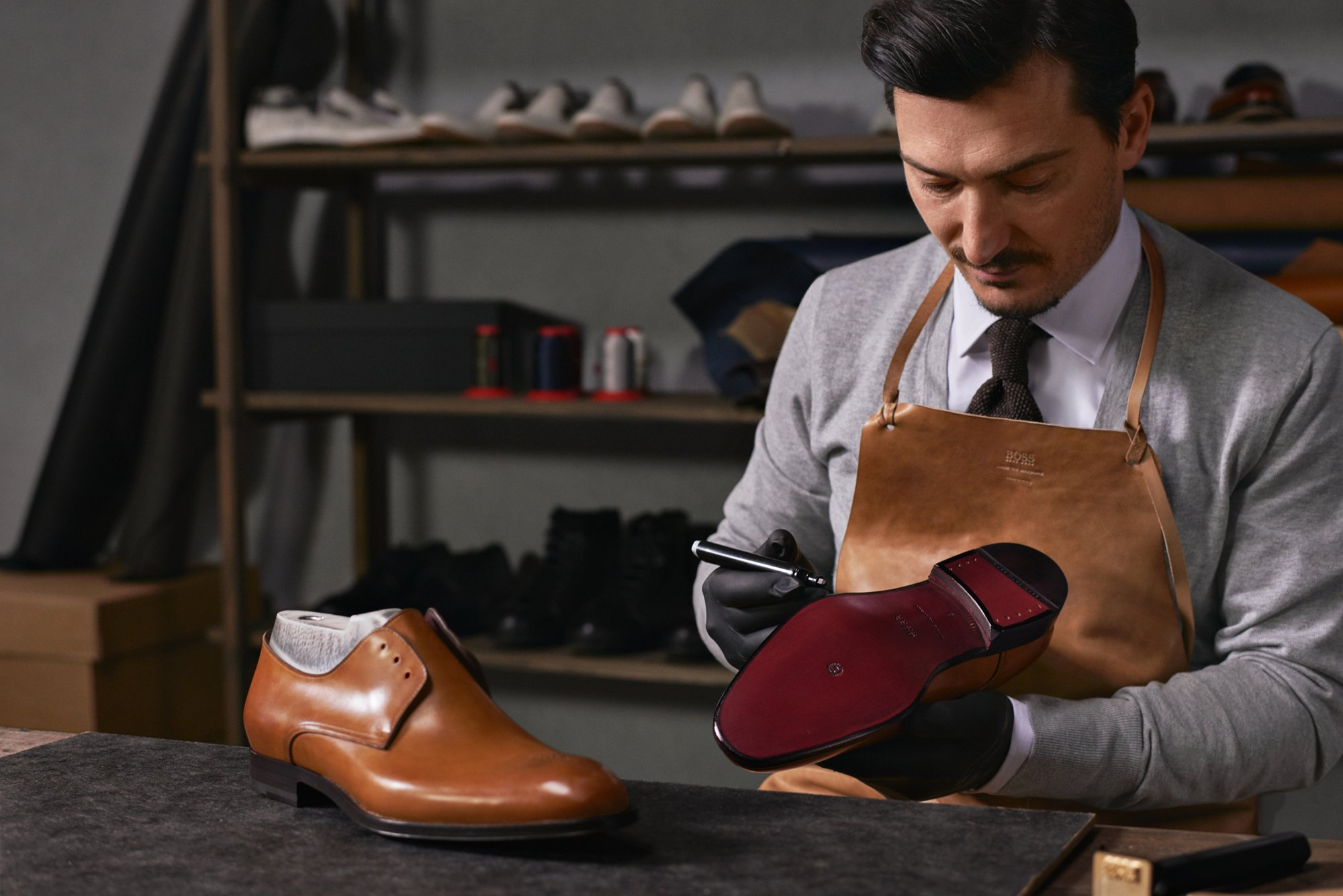 Artisan shoemaker at the HUGO BOSS production facility in Morrovalle, Italy