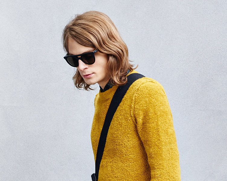 Yellow knitwear over a black shirt and sunglasses by BOSS Orange