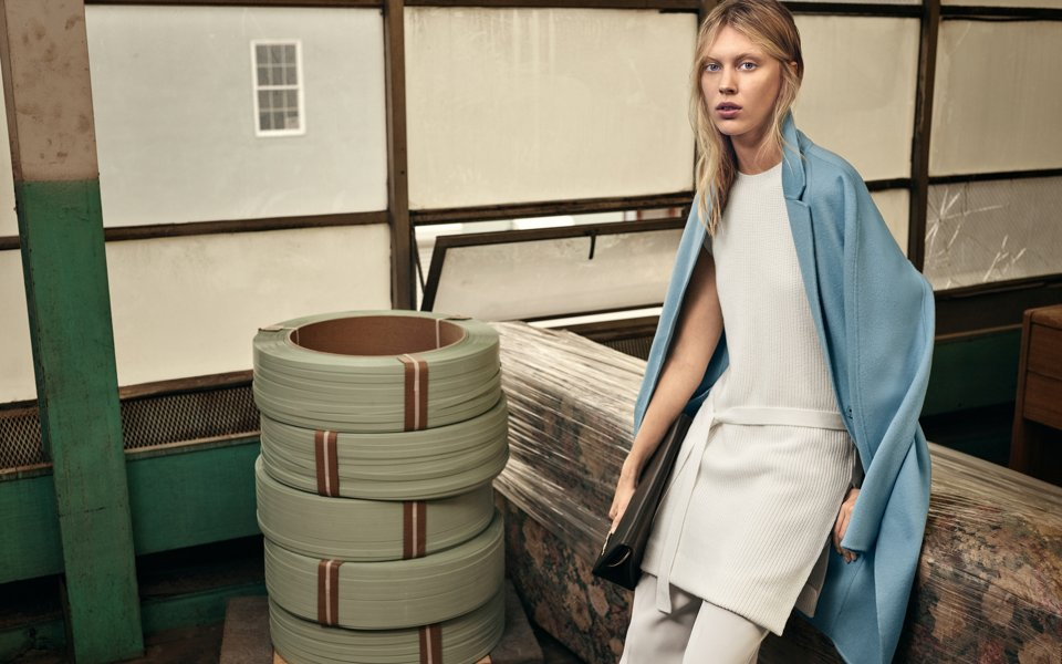 Blue coat, white knitwear and trousers with a black bag by BOSS