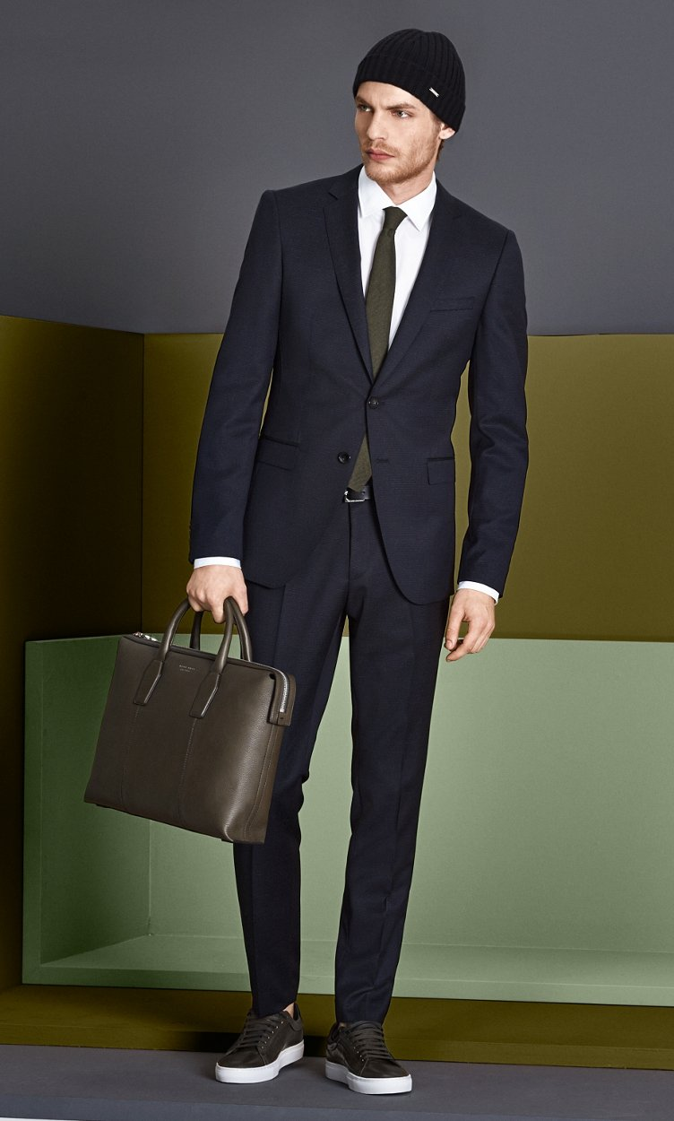 Black suit, white shirt and brown bag by BOSS