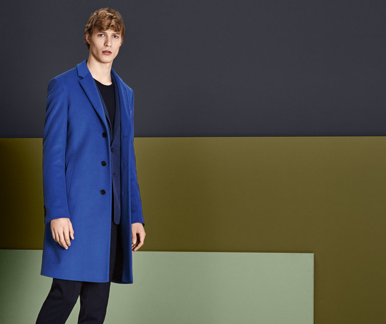 Blue coat with black knitwear and trousers by BOSS