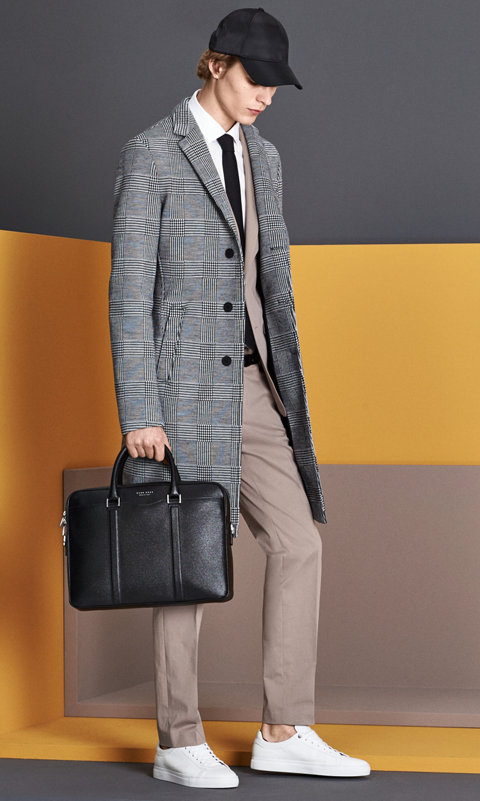 Grey coat, beige suit, white shirt with a black hat and black bag and white sneakers by BOSS