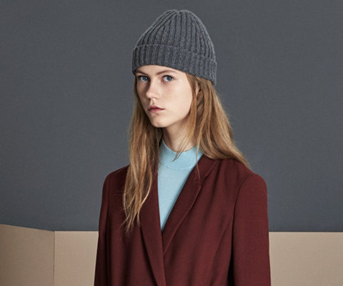 Dark red dress, blue knitwear and grey hat by BOSS