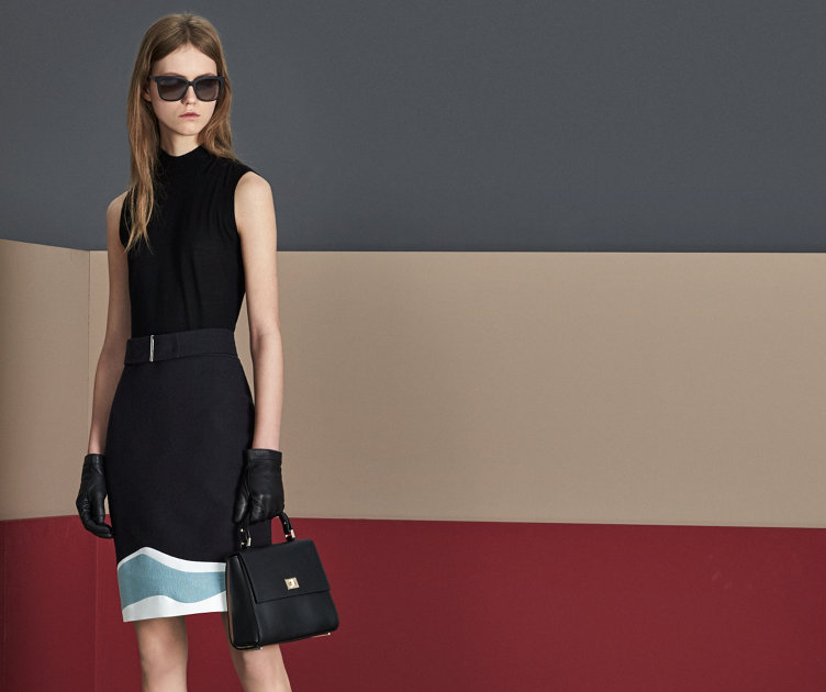 Black dress with black bag and shoes by BOSS