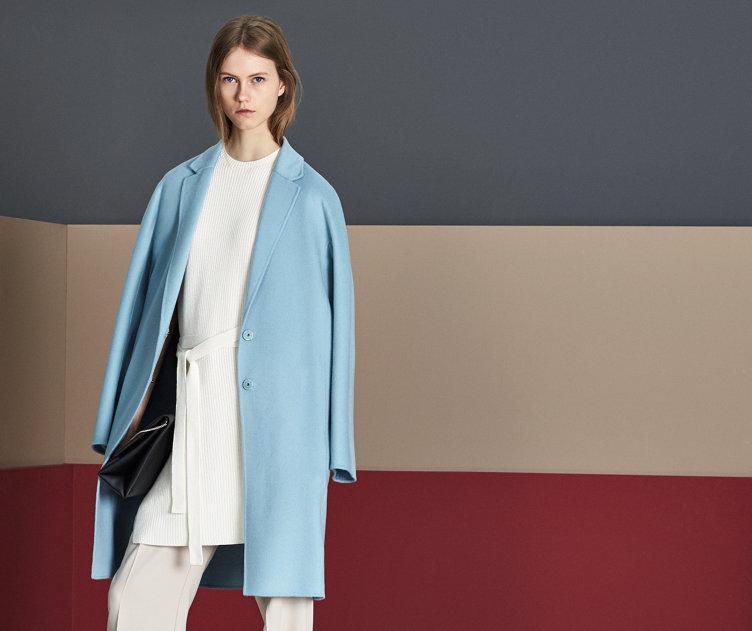Blue coat, white knitwear and beige trousers by BOSS
