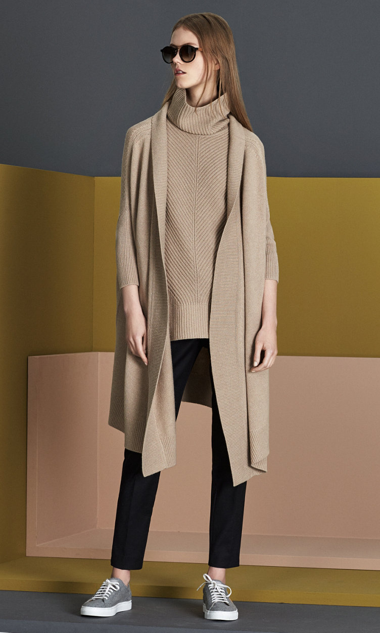 Dark grey coat over brown knitwear with a grey hat by BOSS